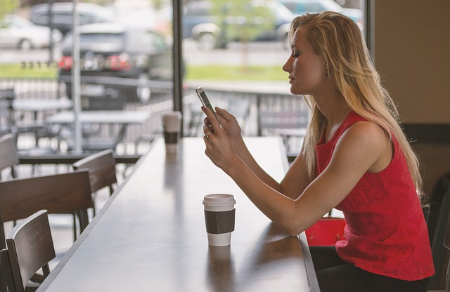 woman using phone for mobile gaming