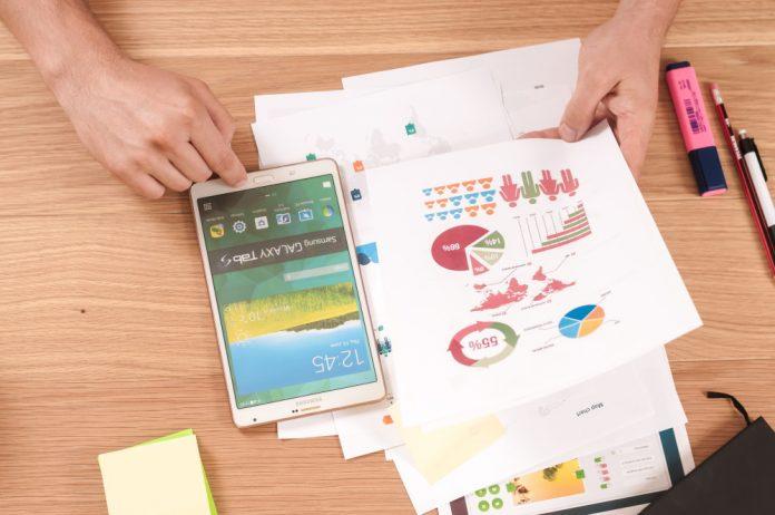 digital marketing desk tablet graphs